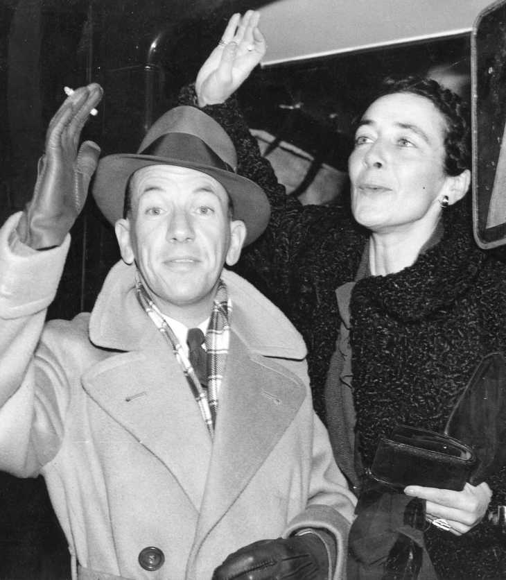 Stylishly attired for travel, Noël Coward and his longtime production designer, Gladys Calthrop, depart Waterloo on the boat train bound for New York, 1936. Credit: Courtesy of The Cinema Museum